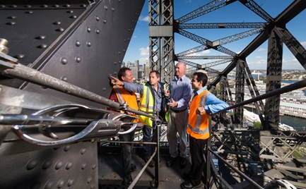 Four men inspecting Sydney Harbour Bridge